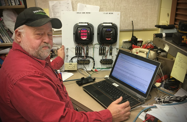 Don Hovland performing meter related programming at his desk
